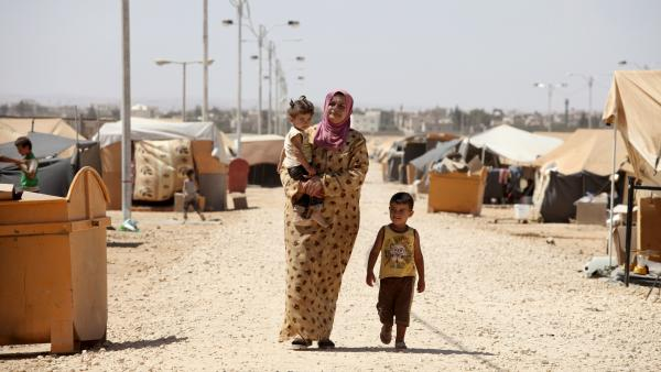 A Syrian refugee walks with her children at Zaatari refugee camp in Mafraq, Jordan, near the Syrian border, Sept. 8. Around 30,000 Syrians live at the camp, with the numbers growing each day.