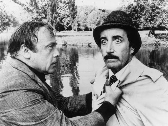 Herbert Lom, left, as police chief Charles Dreyfus and Peter Sellers as Inspector Clouseau in the 1976 film <em>The Pink Panther Strikes Again</em>.