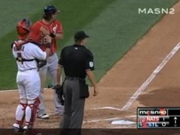 Michael Morse (in red) pretends to swing again before going on another home run trot.