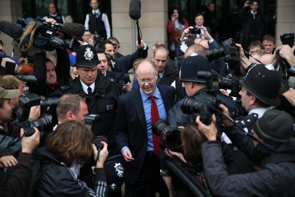 BBC Director General George Entwistle leaves Portcullis House in Parliament after giving evidence to a select committee on Tuesday.