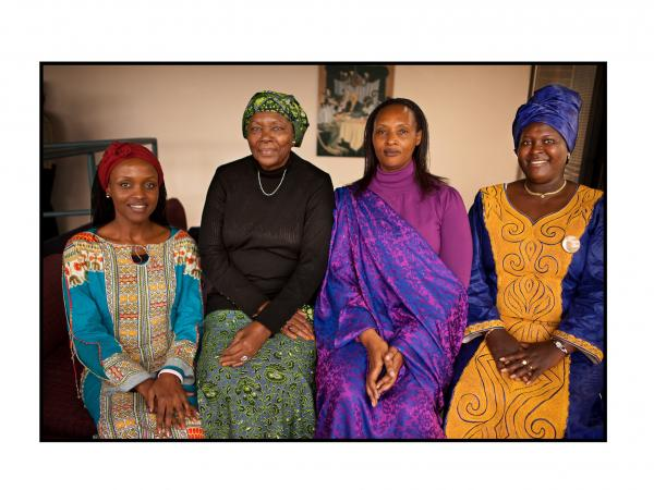 """Its a new Rwanda,"" says Immy Kamarade (second from right), who says women today have access to education, to open an account and to land ownership."