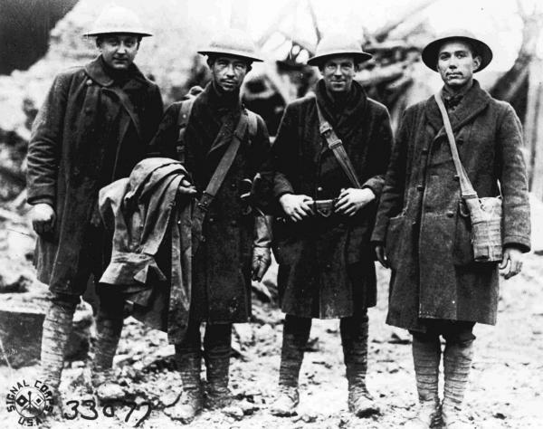 Four U.S. soldiers, runners for the 315th Infantry, pose in France in November 1918. The troops reportedly carried official orders to Lt. Col. Bunt near Etraye, France, shortly before noon, Nov. 11, 1918, announcing that the armistice had been signed, thereby ending World War I.
