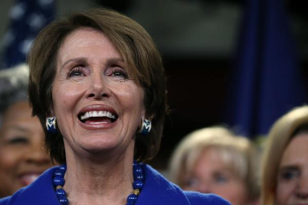House Minority Leader Rep. Nancy Pelosi smiles while speaking to the media.