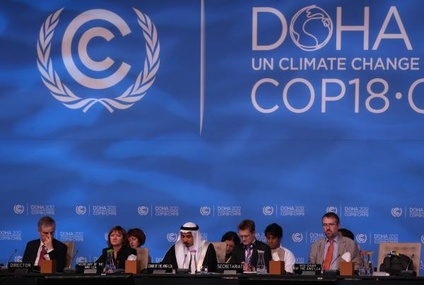 Delegates attend the last day of the U.N. climate talks in Doha, Qatar, on Friday. U.N. climate negotiators locked horns on the final day of talks in Doha to halt the march of global warming, deeply divided on extending the greenhouse gas-curbing Kyoto Protocol and funding for poor countries.