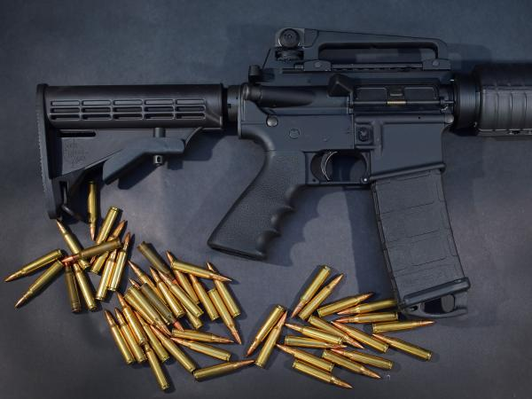 In this photo illustration, a Rock River Arms AR-15 rifle is seen with ammunition.