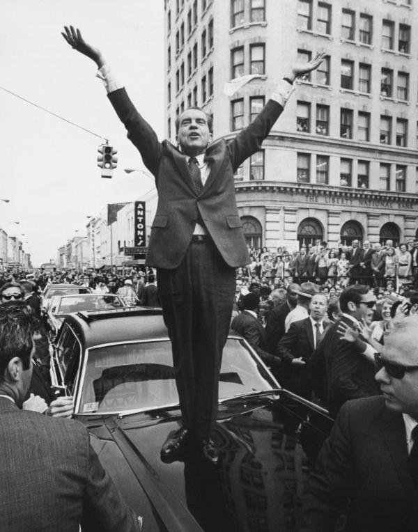 President Nixon stands on a car as he campaigns in 1960.
