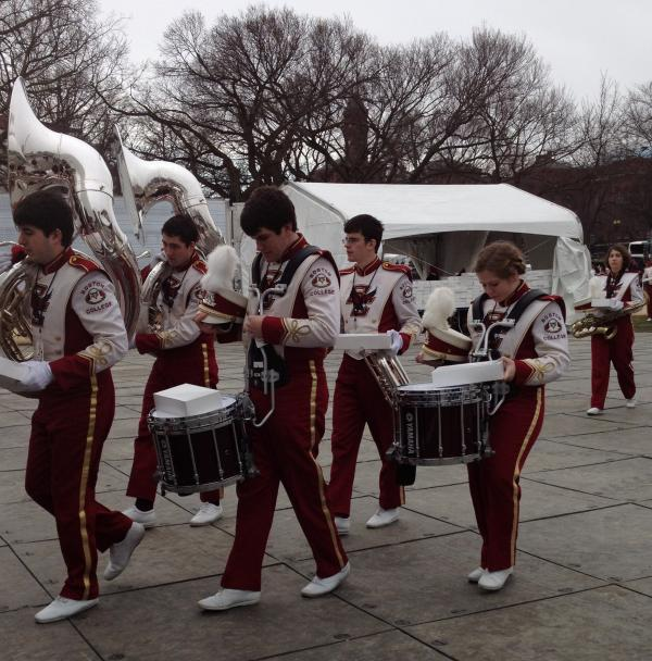 The Boston College marching band tunes up prior to performing along the National Mall.