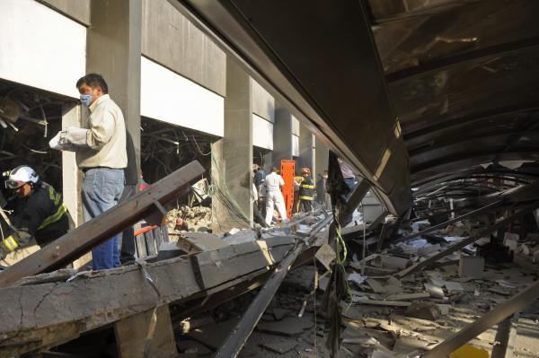 Firefighters belonging to the Tacubaya sector and workers dig for survivors after an explosion at a building adjacent to the executive tower of Mexico's state-owned oil company PEMEX.
