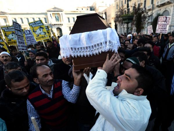 Members of the Pakistani community in Athens carry the coffin of Shehzad Luqman, the victim of what appears to have been a racist attack, on Jan. 19. It's the latest in a wave of violence associated with the right-wing, anti-immigrant Golden Dawn party.