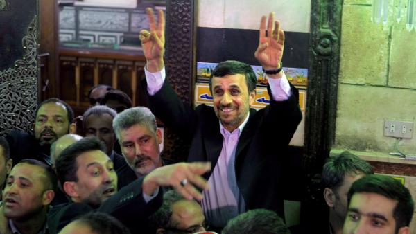 Iranian President Mahmoud Ahmadinejad visits an Islamic shrine Tuesday in Cairo. He became the first Iranian leader to visit Egypt since the 1970s.