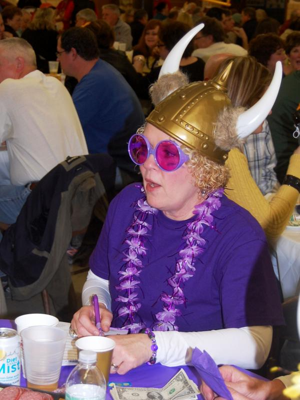 Not everyone dresses up for trivia night, but since her table at St. Rita was named for the Minnesota Vikings, Laura Mueller couldn't resist.