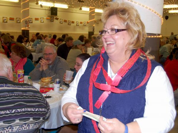 Raffles are a good way to raise money, with winners and the house splitting the pot. Mary Tevlin, who teaches art, gets ready to buy more tickets at St. Rita's trivia night.