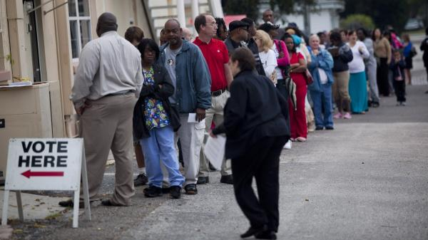 Lines of voters wait to cast their ballots as the polls open in St. Petersburg, Fla., on Nov. 6.