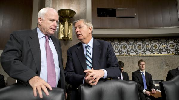 Sens. John McCain, R-Ariz., and Lindsey Graham, R-S.C., confer at the start of a Senate Armed Services Committee hearing last week on the appointments of military leaders. McCain and Graham have been among the Republicans pushing the Obama administration for answers about the Benghazi attack.