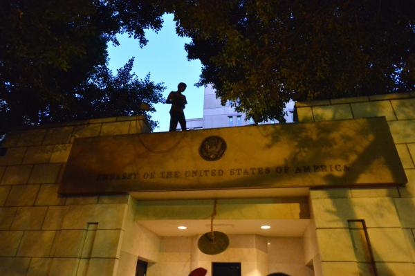 An Egyptian protester stands above the entry of the U.S. Embassy in Cairo on Sept. 11, 2012, during a demonstration against a film deemed offensive to Islam.