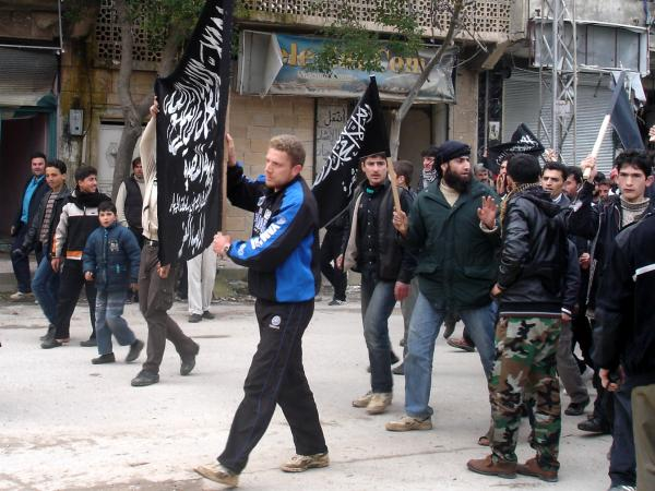 Islamists from Jabhat al Nusra stage their own protest in the town. Until recently, the group has been reluctant to appear in public.