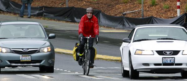 "Washington State Rep. <a href=""http://houserepublicans.wa.gov/ed-orcutt/"">Ed Orcutt</a> has apologized for saying  ""the act of riding a bike results in greater emissions of carbon dioxide from the rider,"" after an email with a bike shop owner sparked criticism. Here, a cyclist rides in Seattle last year."