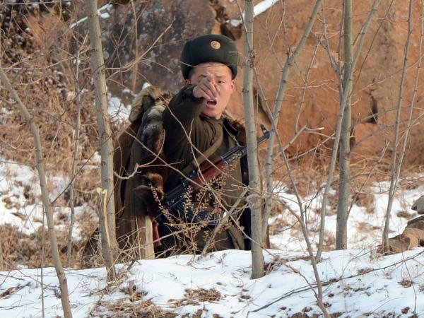 A North Korean soldier reacts as he patrols along the Yalu River near the Chinese border last month.