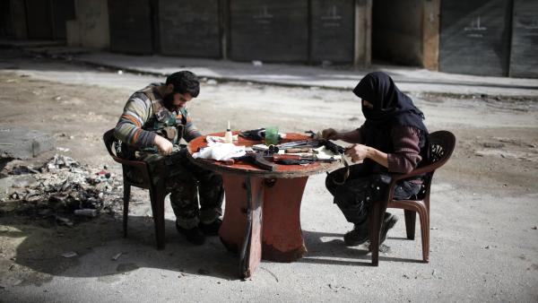 Members of Jabhat al-Nusra clean their weapons, in Aleppo in December. The Islamist rebel group has become an increasingly powerful force in Syria's civil war.