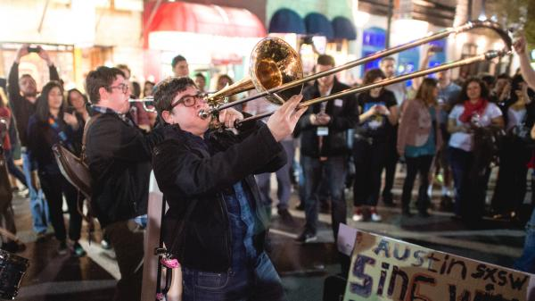 <strong>Twin Horns Of Joy?</strong> Members of the band The Bottom Dollars play on the street in Austin, Texas, during the opening night of the South by Southwest music festival.