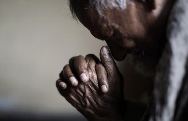 A worshipper prays during Good Friday Mass in Islamabad, Pakistan.