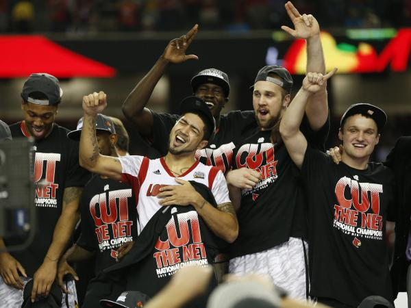 The Louisville Cardinals celebrated after beating Michigan 82-76 in the NCAA Men's Basketball Championship at the Georgia Dome in Atlanta.
