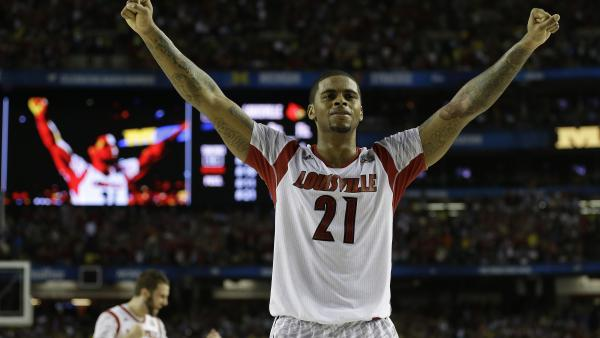 Louisville forward Chane Behanan celebrates after defeating Michigan in the NCAA basketball championship on Monday. It was the school's first basketball title since 1986.