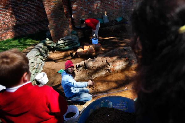 Archaeologists excavate a section of the fort near a church tower that was built in the 17th century.