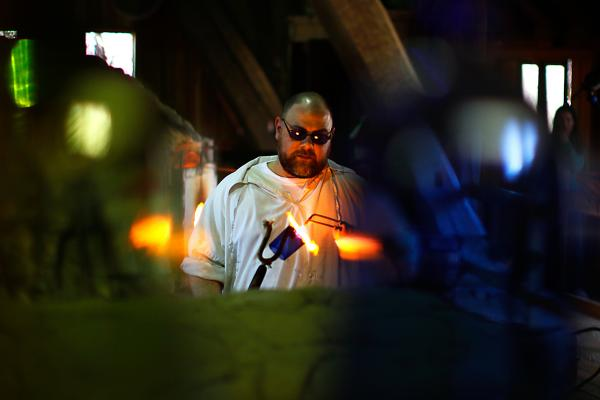 Glass blower Ron Rogers works in a replica factory near the site of the original Jamestown kiln. He practices his craft just as the colonists did, except for using gas-fueled ovens instead of wood-fired ones.