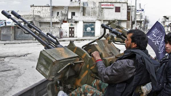 Free Syrian Army fighters sit behind an anti-aircraft weapon in Aleppo, Syria, in February. The rebels say U.S.-provided weapons would help in their fight against Bashar Assad's regime.