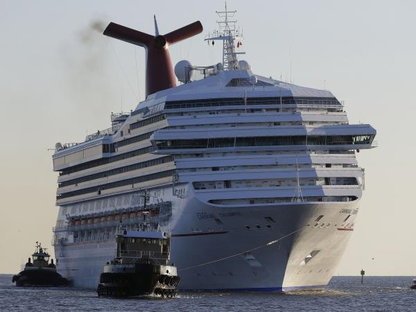 The cruise ship Carnival Triumph, seen here as it arrived in Mobile, Ala., in February, has now disembarked for the Bahamas. The powerless ship was towed to port with 3,143 passengers aboard in February.