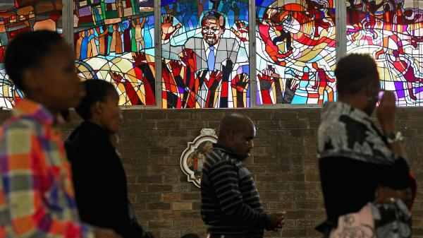 Congregants pray in front of a stained-glass window depicting South African statesman Nelson Mandela during Easter services at Regina Mundi Catholic Church in the Soweto of Johannesburg, South Africa, March 3. The church held prayers for Mandela, 94, who was in the hospital at the time.