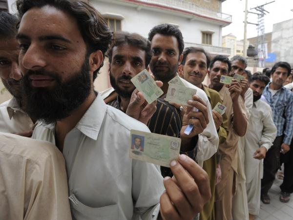 Pakistani men lined up to vote in Rawalpindi on Saturday. Men and women cast ballots separately as millions went to the poll.