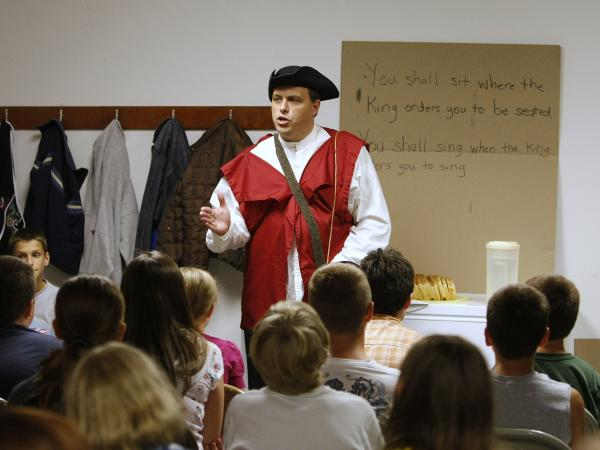 Eric Wilson, head of the Kentucky 9/12 Project, portrays a representative of the tyrannical kingdom as he talks to children on the first night of Vacation Liberty School at a church in Georgetown, Ky., in 2010.