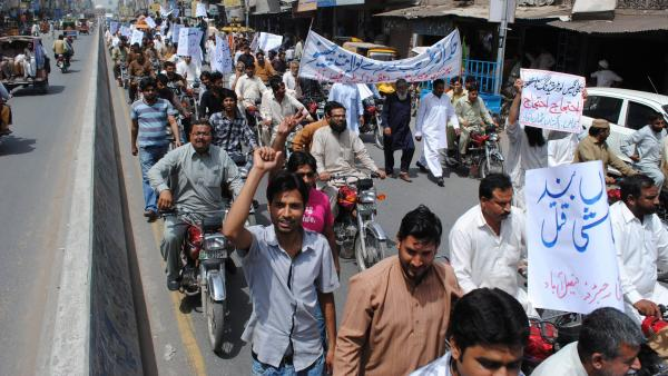 Protesters march against prolonged power outages in Faisalabad, Pakistan, last month. The country faces power outages of more than 18 hours a day in some parts of the country.