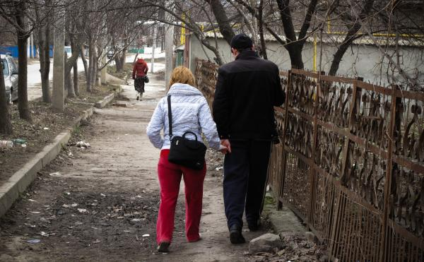 Oxana and Pavel Rucsineanu walk to the tuberculosis hospital in Balti, Moldova. Oxana and their new baby live in an apartment, but Pavel still has to stay at the TB ward, fighting for his life.