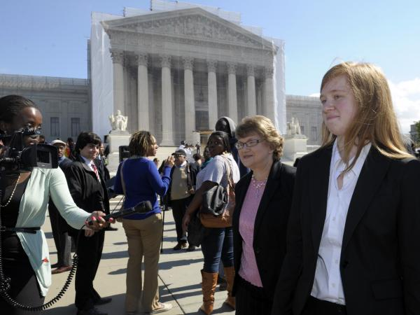 Abigail Fisher (right), the Texan involved in the University of Texas affirmative action case, walks outside the Supreme Court in 2012.