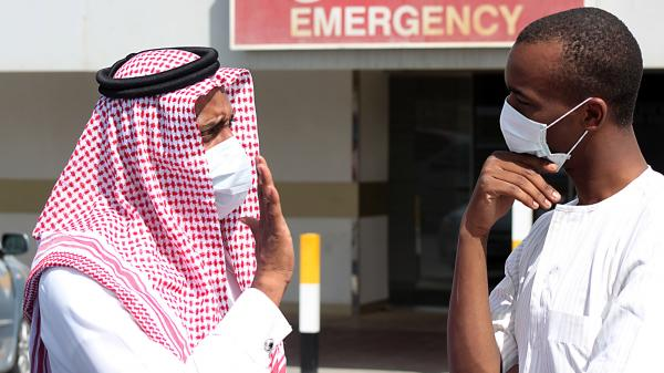 Men outside a hospital in Dammam, Saudi Arabia, wear surgical masks as a precaution against infection with a coronavirus.