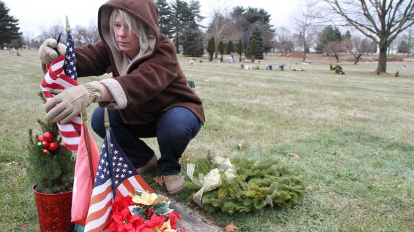 "Anna Rodriguez tends the grave of her son, Nick. She learned shortly after Nick's death that, because his death was a suicide, <a href=""http://longhaul.pro/memorial/"">his name would not be included on a local memorial</a> to fallen soldiers. She has since found a memorial garden in York, Pa., that will add Nick's name to its memorial wall this summer."