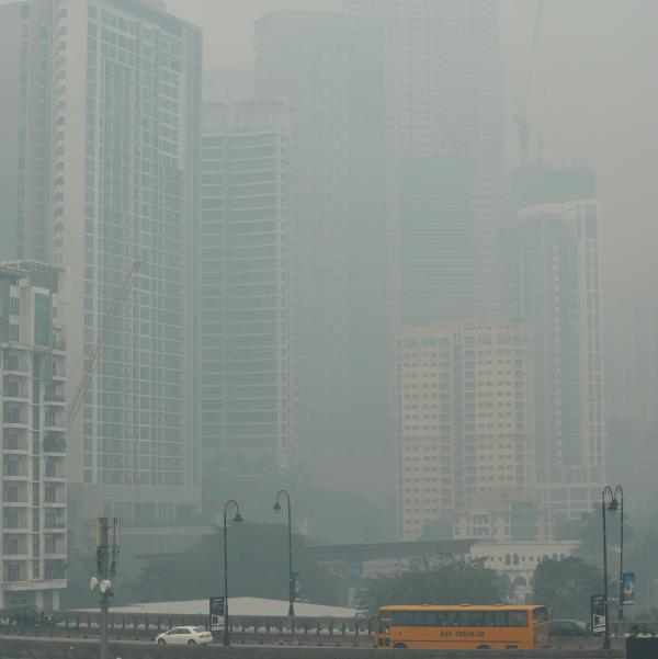 The landmark Petronas Twin Towers (top, right) in the Malaysian capital, Kuala Lumpur, are barely visible amid the thick smoke. It's even worse farther south.