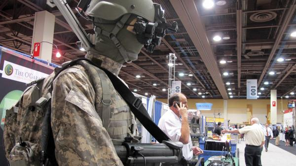 A mannequin in night-vision goggles is part of a display at a border-security expo in Pheonix last year. Defense companies are seeking growth in markets in the developing world, or in homeland and cybersecurity.