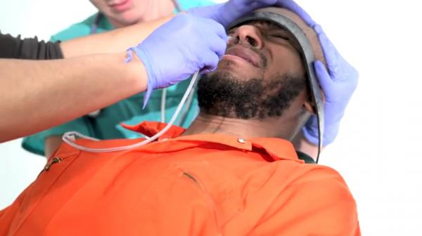 To raise awareness about force-feeding, Yasiin Bey, the musician and actor formerly known as Mos Def, in a video voluntarily underwent the same procedure administered to prisoners who refuse solid food in political protest while they are held in Guantanamo Bay.