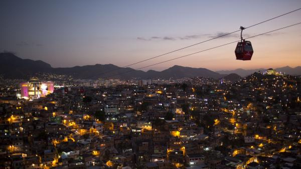 Cable cars move commuters over a complex of shantytowns in Rio de Janeiro, one of many cities taking part in the smart city boom around the world.