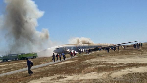 Passengers move away from Asiana Airlines Flight 214 on Saturday in San Francisco. This photo was taken by a passenger.