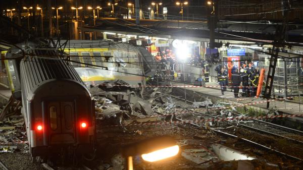 Rescuers work into the night to search the site of a train derailment near Paris, called the worst rail accident in France in the past 25 years.