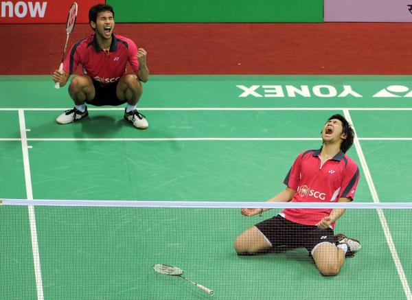 <strong>Happier Times:</strong> Badminton players Issara Bodin, right, and Jongjit Maneepong of Thailand celebrate after defeating Korean badminton players Ko Sung Hyun and Yoo Yeon Seong at the Yonex-Sunrise India Open 2012 in New Delhi on in April of 2012.