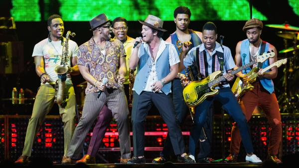 <strong>Just One Of The Guys:</strong> Bruno Mars (center, with microphone) performs with his band at Key Arena in Seattle, Washington on July 21.