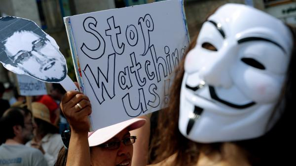Protesters demonstrate against alleged NSA surveillance in Germany during a rally in Hannover, Germany, on Saturday.
