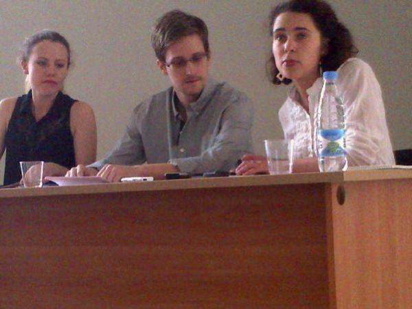 Edward Snowden has chosen where to live in Russia, which granted him asylum Thursday, his lawyer said. Here, Snowden is seen at Moscow's Sheremetyevo airport on July 12. At left is WikiLeaks' Sarah Harrison.