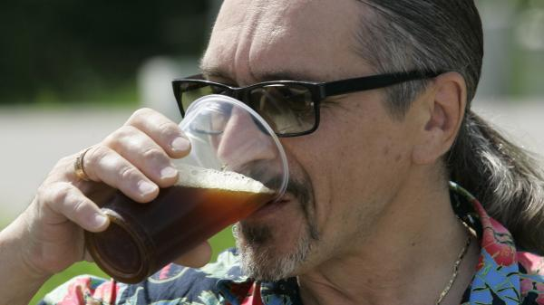 A man drinks fresh <em>kvas</em>, the ancient Russian fermented-bread drink, in Zvenigorod, 35 miles west of Moscow.